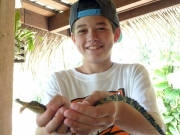 Co-founder, Max Guinn, with his first juvenile Morelet's crocodile