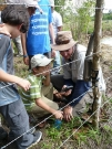 KidsEcoclub out checking camera traps, with LFRC intern, Matt Thornton
